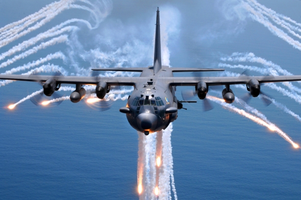 United States Air Force AC-130H Spectre gunship jettisons decoy flares